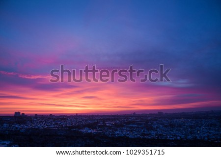 Panoramic view from the window. Dawn in the city Royalty-Free Stock Photo #1029351715