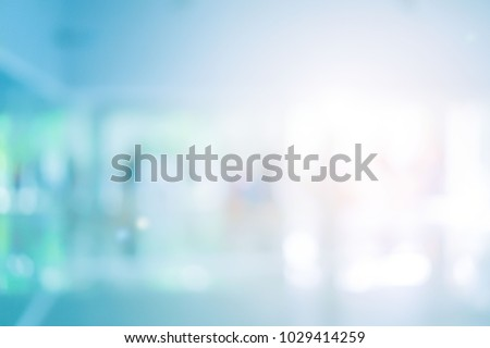 abstract blurred of hospital corridor blue color background concept. Royalty-Free Stock Photo #1029414259