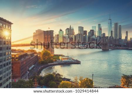 Retro style New York Manhattan with Brooklyn Bridge and Brooklyn Bridge Park in the front. #1029414844