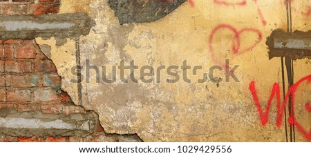 Vintage Brown White Yellow Distressed Brick Wall With Graffiti Urban Street Art Rough Wide Texture Or Grunge Background. Worn Concrete Wall With Painted Lines And Drawing. Grungy Grafitti Web Banner. #1029429556