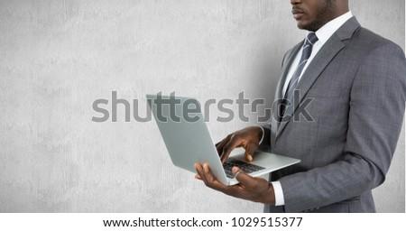 Digital composite of Composite image of smiling businessman using computer #1029515377
