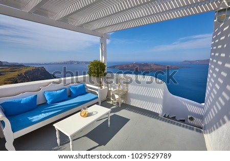 Fira town on Santorini island, Greece. Incredibly romantic view from terrace on Santorini. Oia village in the morning light. Amazing sunset view with white houses. Island lovers #1029529789