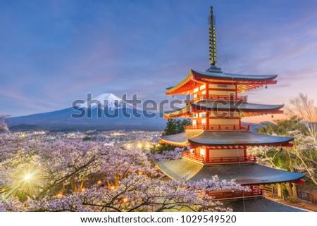 Fujiyoshida, Japan view of Mt. Fuji and pagoda in spring season. #1029549520