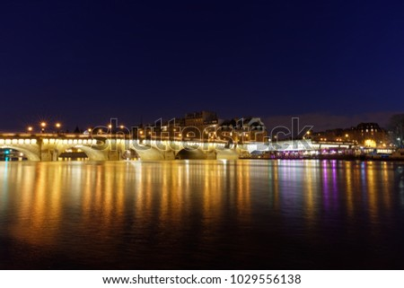Paris, France - February 18, 2018: View of Pont Neuf, old bridge in Paris by night #1029556138