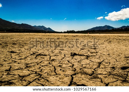Erosion of the ground at Theewaterskloof dam in South Africa during the worst drought in history due to climate change. In this photo I am standing in the middle of where the dam is supposed to be.  #1029567166