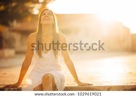 Carefree woman enjoying in nature,beautiful red sunset sunshine.Finding inner peace.Spiritual healing lifestyle.Enjoying peace,anti-stress therapy,mindfulness meditation.Positive energy.Freedom #1029619021