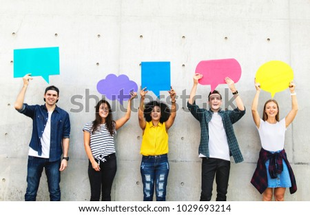 Group of young adults outdoors holding empty placard copyspace thought bubbles #1029693214