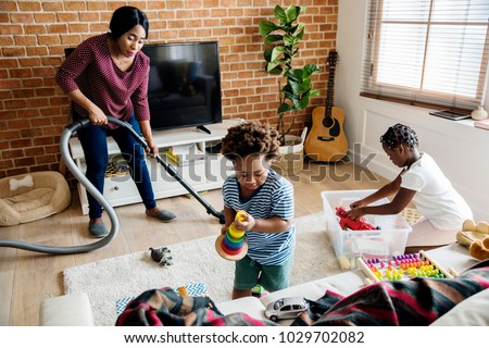 Black family cleaning the house together #1029702082