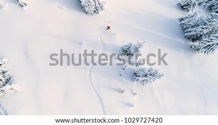 Snowboarder Drone Angle Powder Turns Fresh Untracked Mountain Powder Snow Aerial View #1029727420