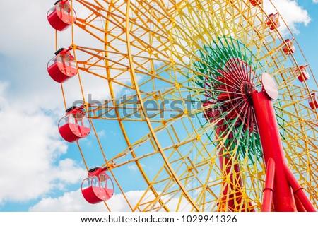Ferris wheel with blue sky in Kobe, Japan #1029941326