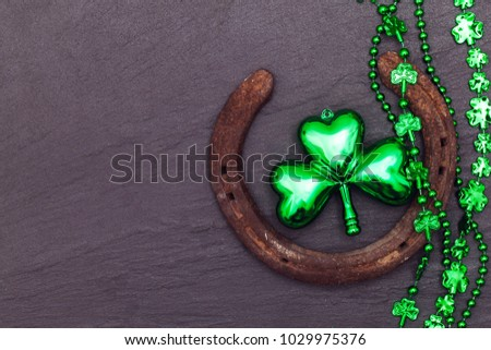 Lucky horse shoe with St Patrick's day green clover decorations #1029975376