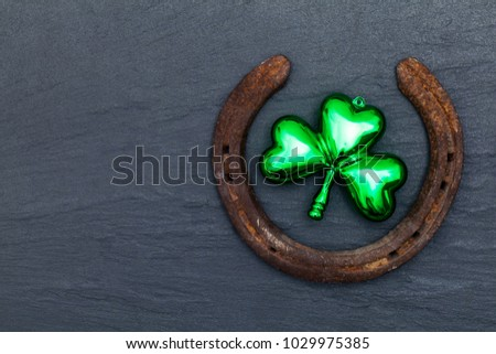 Lucky horse shoe with St Patrick's day green clover decorations #1029975385