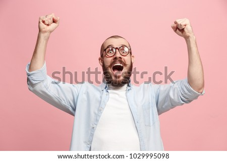 I won. Winning success happy man celebrating being a winner. Dynamic image of caucasian male model on pink studio background. Victory, delight concept. Human facial emotions concept. Trendy colors Royalty-Free Stock Photo #1029995098