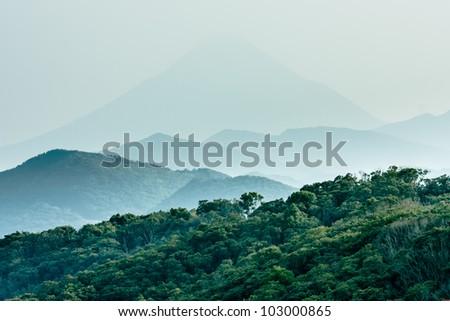 Layered hills with Mount Kaimon (Kaimondake) in the background #103000865