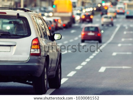 Blurry cars and traffic in the city #1030081552