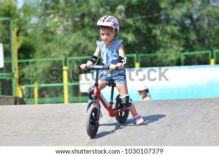 Orenburg, Russia - July 29, 2017 year: little kids learn to ride on Begovel