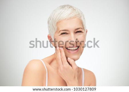 Portrait of beautiful senior woman in front of white background. #1030127809