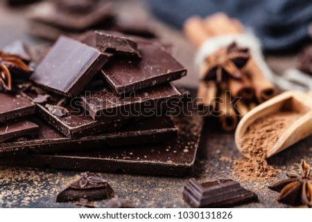 Chocolate bar pieces. Background with chocolate. Sweet food photo concept. The chunks of broken chocolate #1030131826