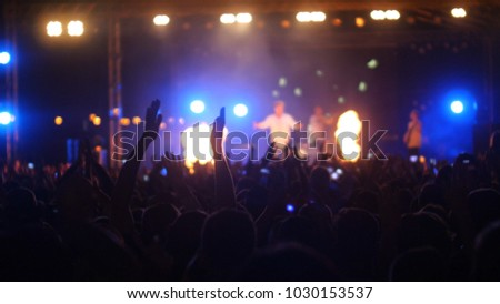 People enjoying and dancing at the open-air concert. #1030153537