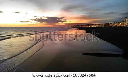 Beach walk at sunset #1030247584