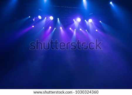 scene, stage light with colored spotlights and smoke Royalty-Free Stock Photo #1030324360