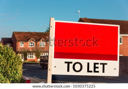 Houses to rent in UK - Real Estate Agent TO LET sign.
