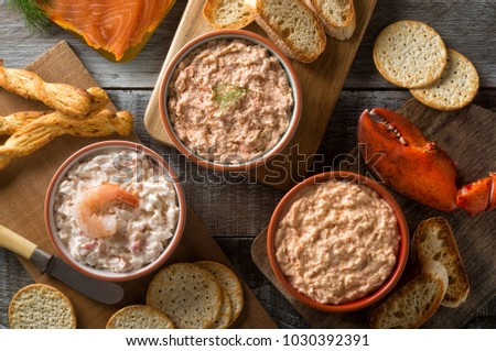 An assortment of delicious seafood dips including lobster dip, smokeds salmon dip, and shrimp dip. #1030392391
