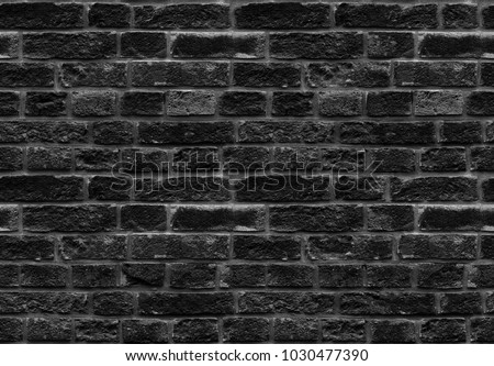 High resolution black seamless brick wall texture pattern background. Seamless worn style burned style brick wall background. Black grey brick wall pattern worn texture. Worn style seamless brick wall #1030477390