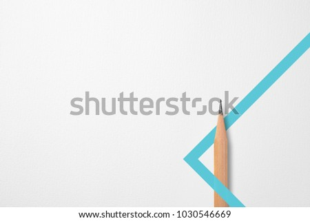Minimalist template with copy space by top view close up photo of wooden pencil isolated on white paper and combination with blue green line shape graphic. Flash light made smooth shadow from pencil.