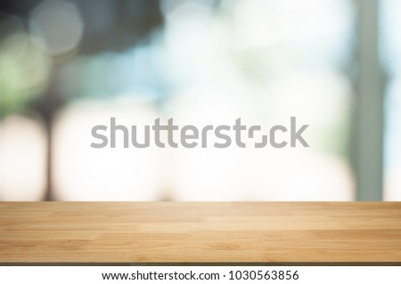 empty wooden table in front of blur montage abstract background #1030563856