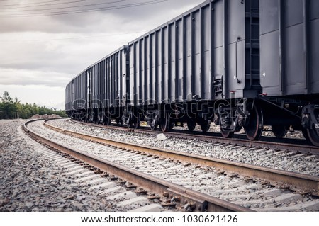 rail freight cars on rails Royalty-Free Stock Photo #1030621426