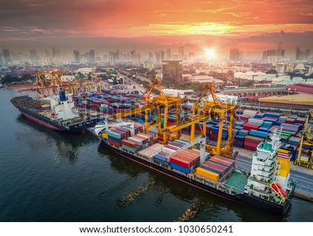 Logistics and transportation of Container Cargo ship and Cargo plane with working crane bridge in shipyard at sunrise, logistic import export and transport industry background #1030650241
