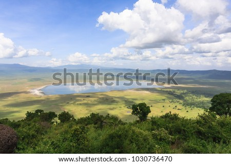 Panorama of NgoroNgoro crater. The lake is inside the crater. Tanzania, Africa Royalty-Free Stock Photo #1030736470