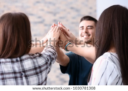 People putting hands together indoors. Unity concept #1030781308