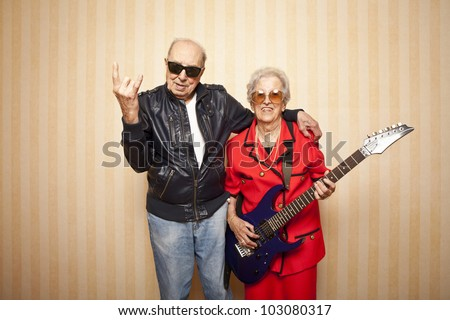 cool fashion elder couple with electric guitar #103080317