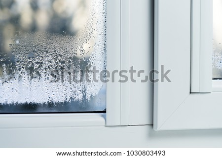 Double glazed PVC window Condensation on the glass Royalty-Free Stock Photo #1030803493