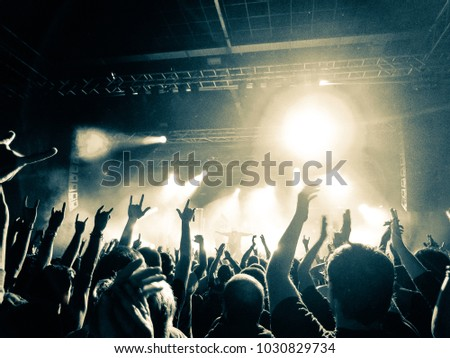 Concert hall with people clapping #1030829734