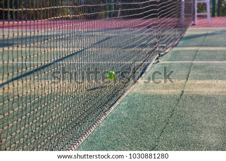 Tennis court with net and ball. Outdoor sports activities #1030881280