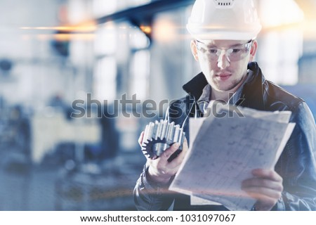 factory engineer checks the quality of the manufactured part Royalty-Free Stock Photo #1031097067