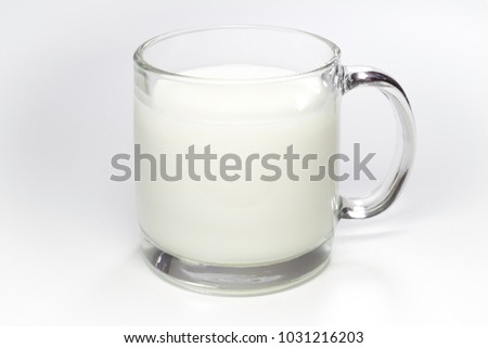 Transparent glass cup of milk on a white background #1031216203