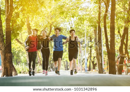 Asia teenagers are running in the morning with fresh air in the park. Running a good exercise helps the body system burn excess fat. Give a good respiratory system. And make you feel relaxed. #1031342896