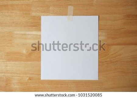 paper note on wooden background #1031520085