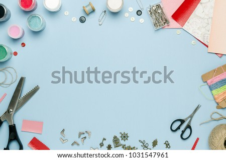 Tools and materials for creativity scattered on the table. Scrapbooking, creative mess. Empty space for text, top view Royalty-Free Stock Photo #1031547961