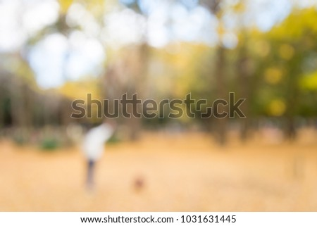 Abstract blur people in city park autumn season bokeh background #1031631445
