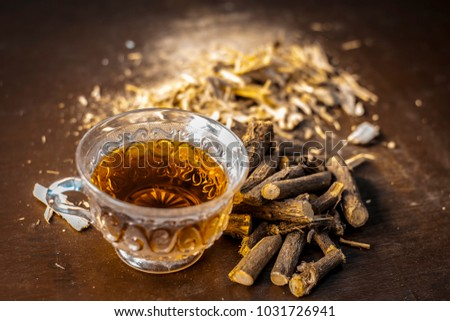 Ayurvedic herb Liquorice root,Licorice root, Mulethi or Glycyrrhiza glabra root and its powder with its tea for detoxifying the body, soothing spasms, easing menstrual cramps, raising blood pressure. #1031726941