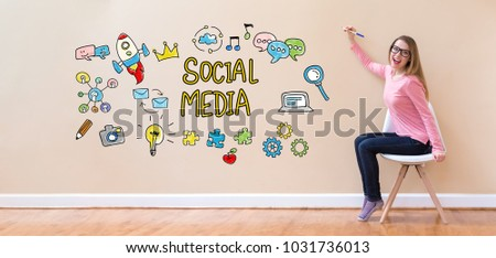 Social Media with young woman holding a pen in a chair #1031736013