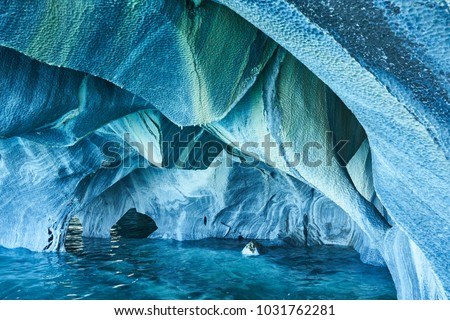 The Marble Caves of Patagonia, Chile. Turquoise colors and splendid shapes create imagery of unearthly beauty carved out by nature.  #1031762281