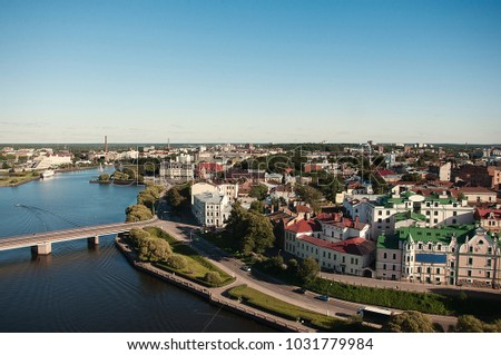 VYBORG, RUSSIA View of Vyborg Township with the river. Vyborg stands at the head of Vyborg Bay of the Gulf of Finland, 113 km northwest of St. Petersburg. #1031779984