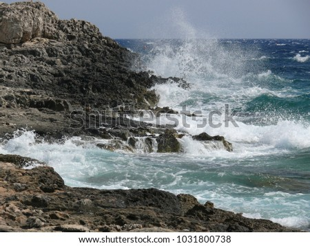 Sea that Slams on the Rocks of Sicily #1031800738