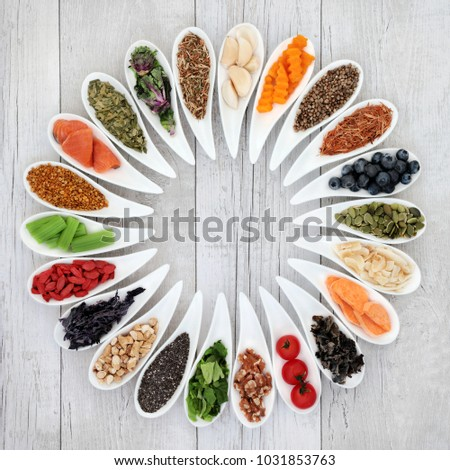 Health food to improve brain power concept with nuts, seeds, medicinal herbs, pollen grain, vegetables and fruit. Super foods high in minerals, vitamins, antioxidants and anthocyanins. Top view. #1031853763